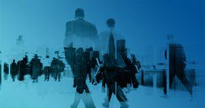 People walking towards office buildings