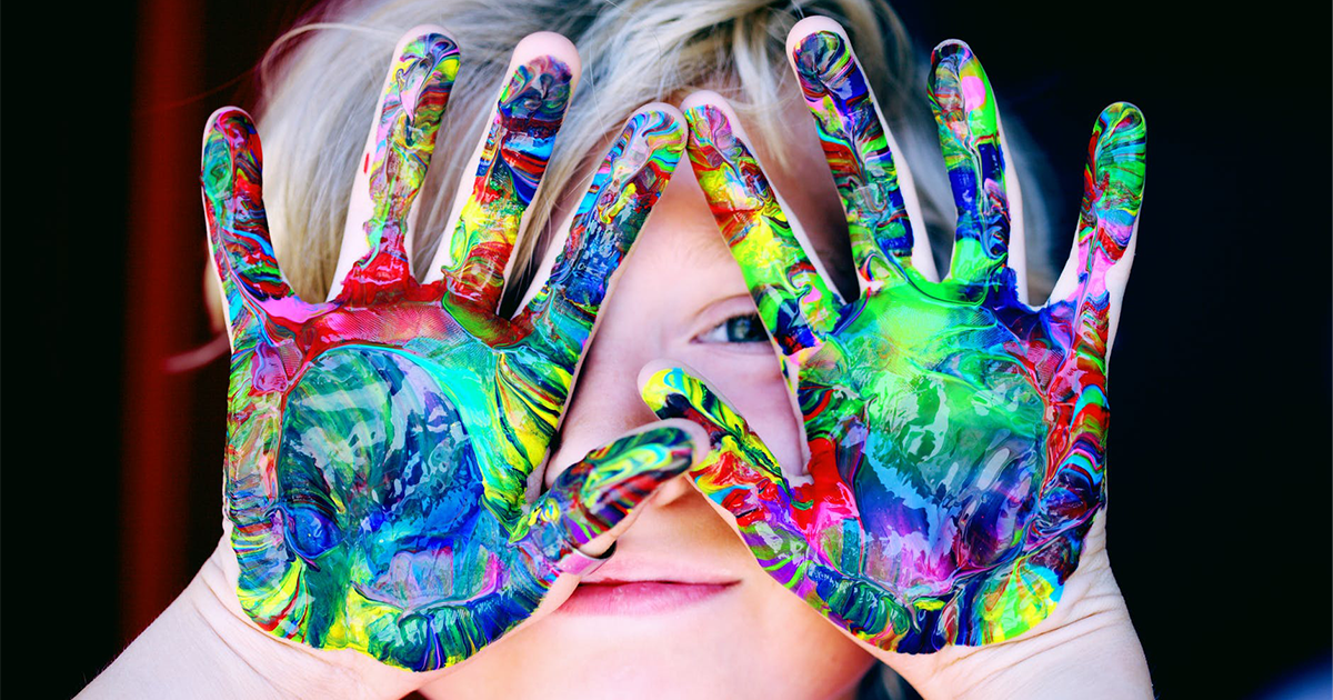 Child with paint on it's hands