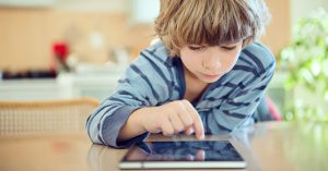 Child working on tablet