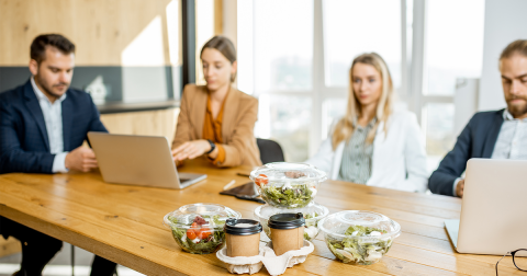 Colleagues in the office with business lunches