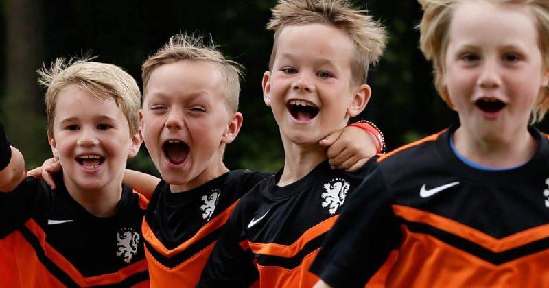 Children wearing a soccer jersey