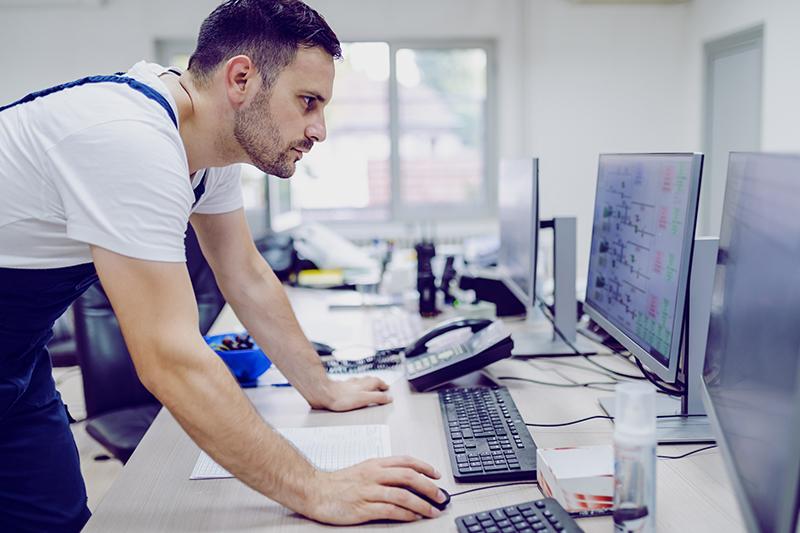 Man checking computer screen
