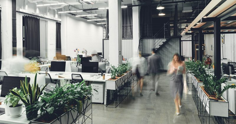 Office interior with blurred colleagues