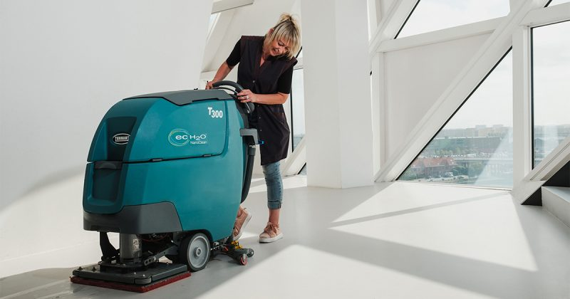 Lady cleaning floor with-T300
