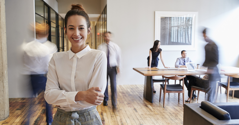 Smiling lady looking at camera in office